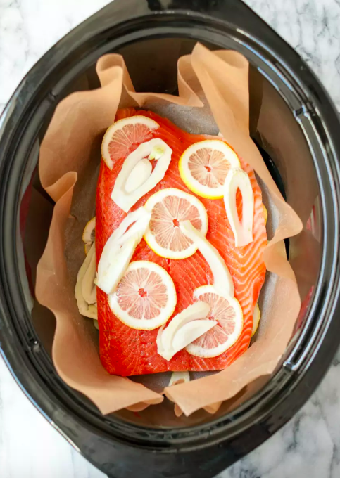 Slow Cooker Salmon  -  Yep, you really can cook salmon in the slow cooker, and it makes the intimidating task of cooking seafood at home a total breeze. Get the recipe .