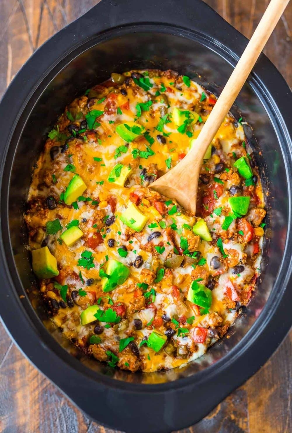 Crock Pot Mexican Casserole  -  This recipe uses ground turkey to keep it light, but you can totally use ground beef or chicken if that's more your style. Get the recipe .
