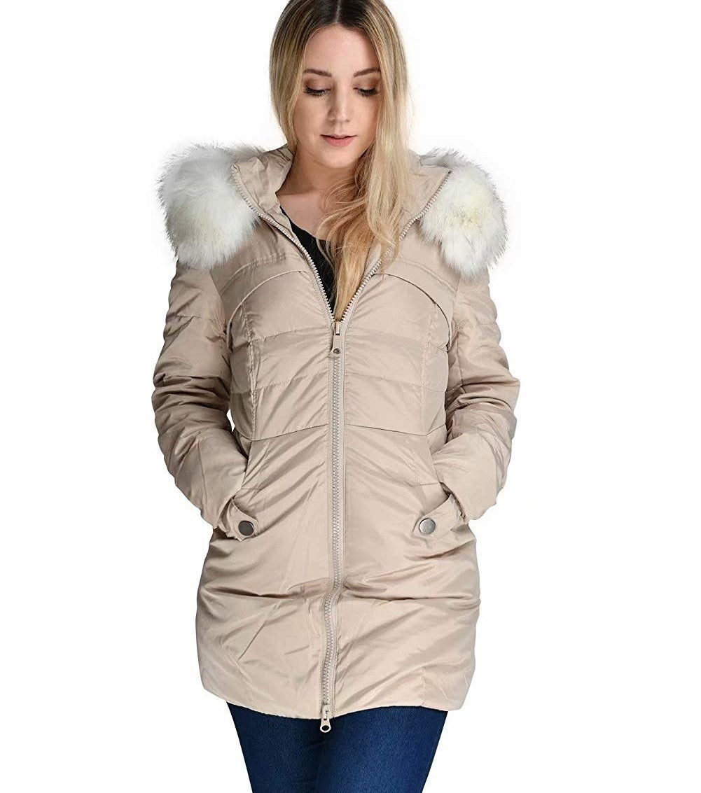 """Promising review: """"I bought this coat to replace an old down coat that is 12 years old and losing feathers. I love everything about this coat. It is lightweight, not bulky, and roomy enough to wear a sweater underneath. Sleeves are long and the fitted cuff keeps the wind out. I am 5'5"""" and 135 lbs., and the large fits perfectly."""" —Michelle M.Price: $89.99+ (available in seven colors, and sizes XS–3XL)"""