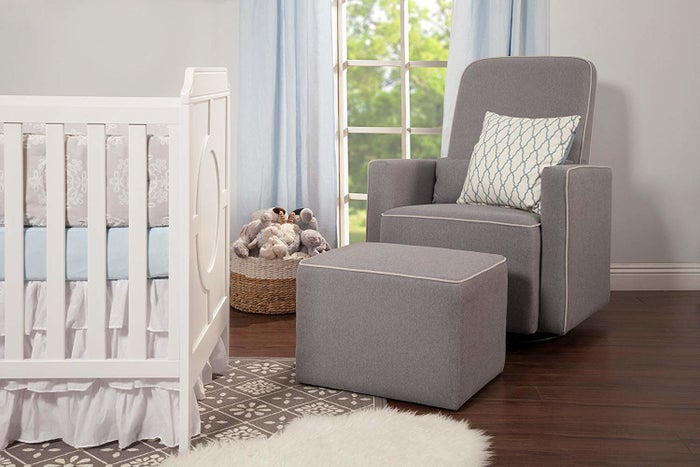 """Promising review: """"I highly recommend this chair!! I bought it for our nursery and I've been using it for about three months with my little one. I nurse in it and it works wonderfully. I""""m 5'6"""" and I use a pillow to nurse and it fits great. It is very well made, good construction, nice material, not scratchy or too soft that you slide around. The chair swivels perfectly. No squeaking! I like it better than having a lazy boy with the footrest that comes out since I use the foot stool to lay things on like burp cloths, folding clothes etc. Its useful in that way. Also my daughter uses it as a stool and moves it about the room playing with it. Great design and look. Definitely recommend."""" —RobinGet it from Amazon for $329 (available in four colors)."""