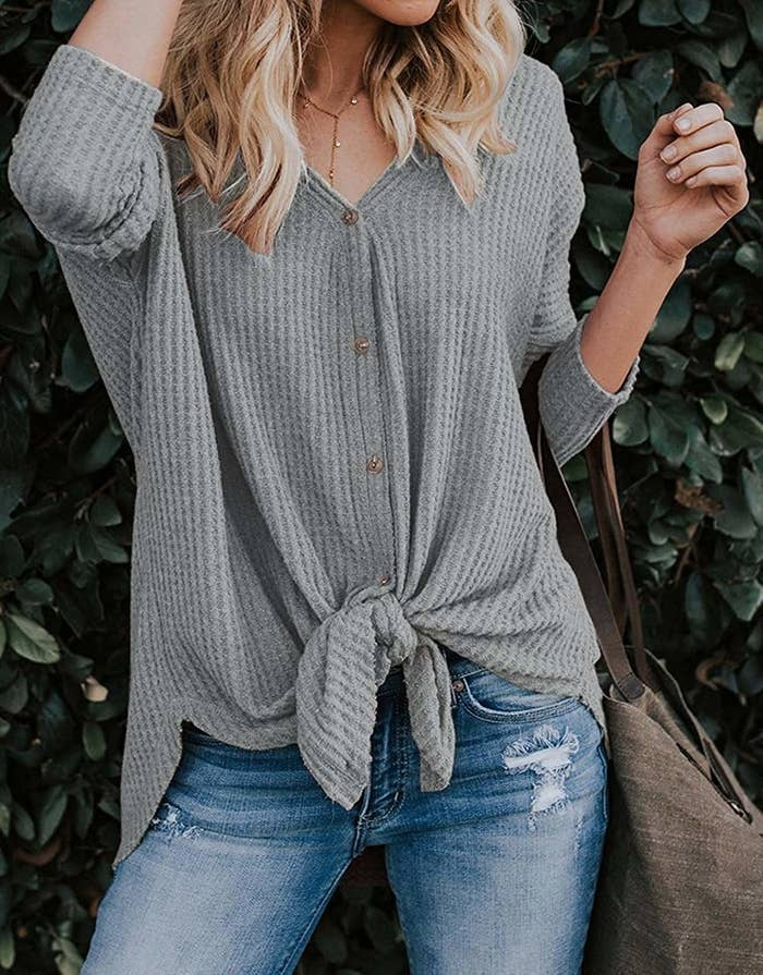 071b63cb5738 A loose knit blouse with an adorable front knot you ll be able to throw on  with your favorite pair of jeans and walk out the door in minutes.