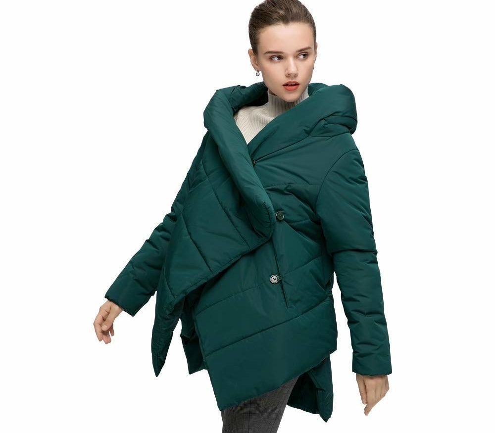 """Promising review: """"This jacket is beautiful!!! I love the fashion forward design. I'm 5'10"""" and 165 lbs. I purchased the 2XL because I wanted an oversized look. I got it. The sleeves are long, they cover my hands. I'm super happy about that! The half hood looks so chic with the way the jacket buttons asymmetrically. The bell silhouette is flattering and looks great with snow leggings. The price is great for all this design. This coat is not for spending hours playing in the snow in single digit temps. Plus, it arrived super fast."""" —ZenRunnerPrice: $55.98+ (available in three colors, and sizes M–2XL)"""
