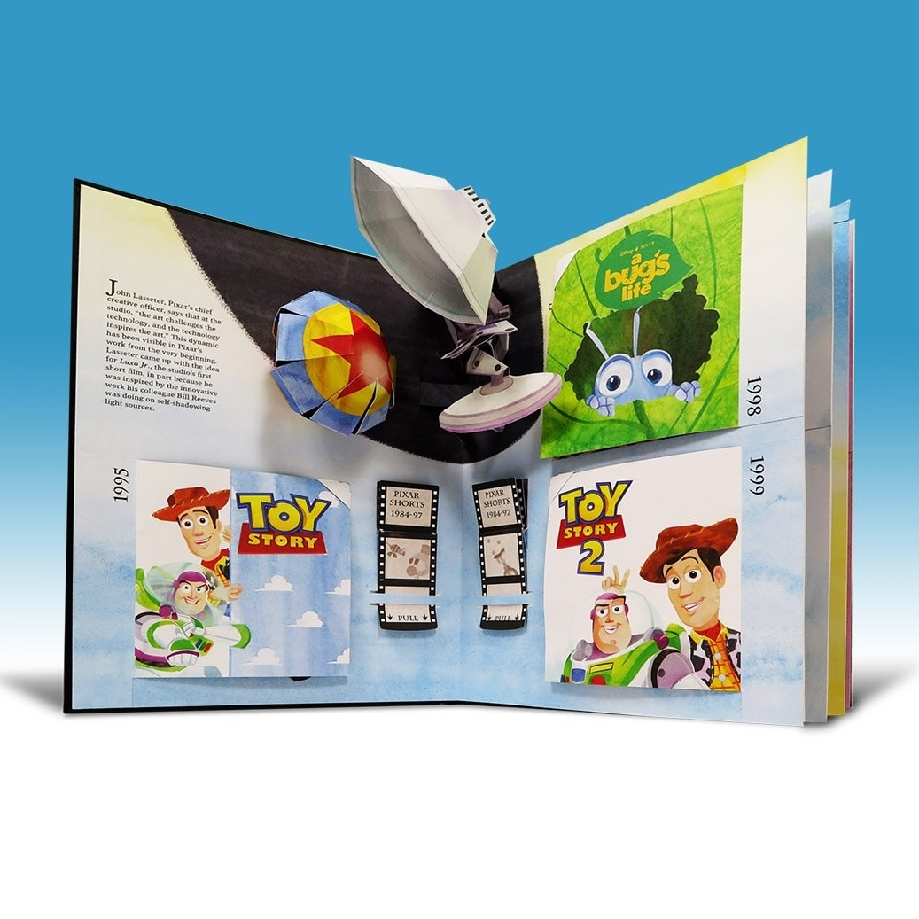 pop up book showing various pixar movies that open up to reveal pop up illustrations