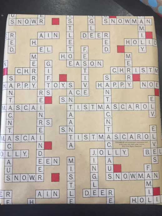 """The person who covered all their presents in this Scrabble wrapping paper — then saw the """"T.I.S.T.M.A.S.C.A.R.O.L."""