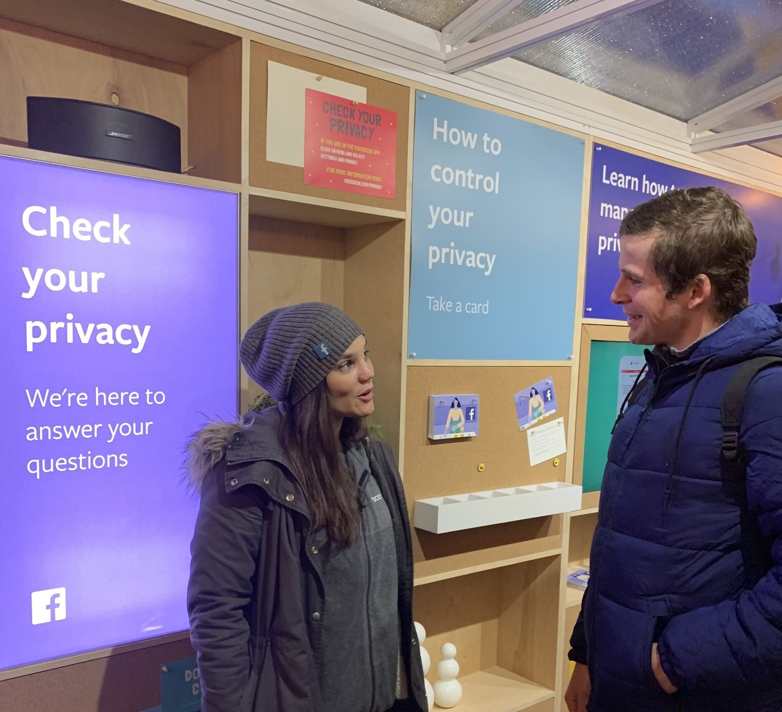 "A Facebook employee chats with Alan, 21, from New Jersey at Thursday's ""Pop-Up shop"" for privacy."