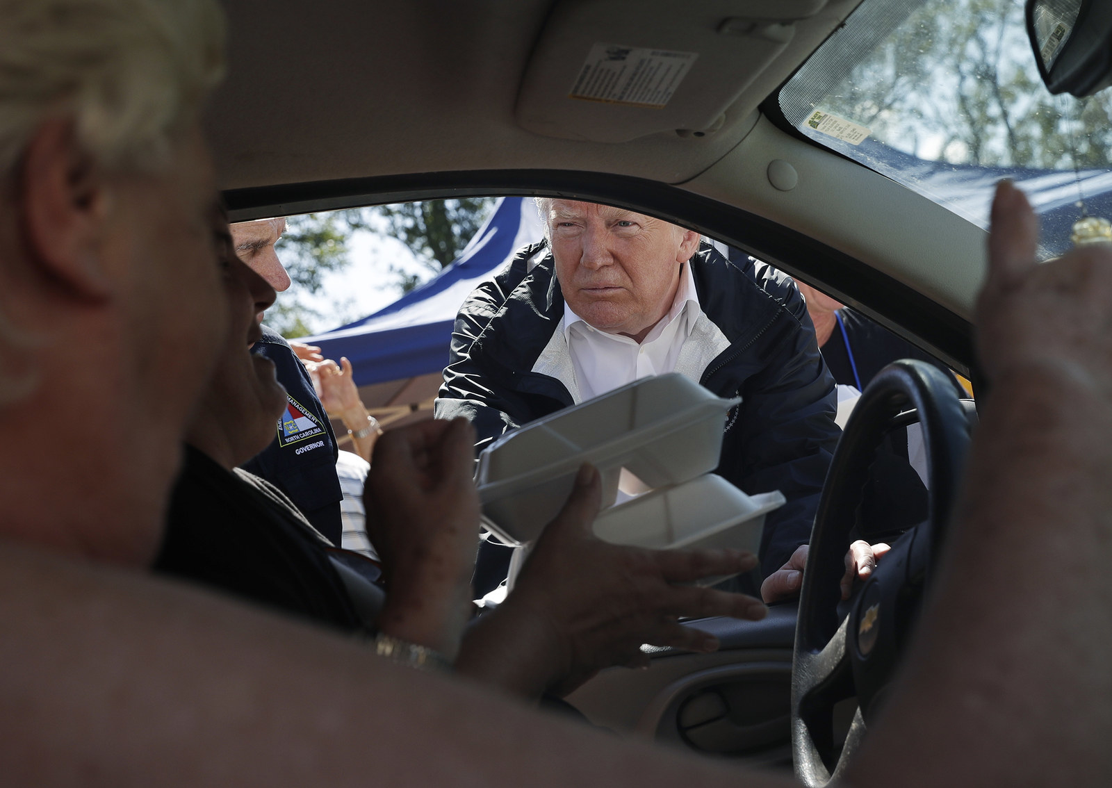 Trump hands out food during Hurricane Florence recovery efforts on Sept. 19 in New Bern, North Carolina.