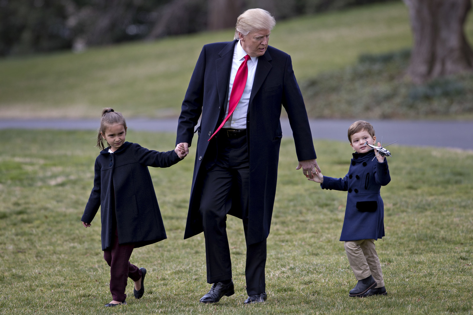 President Trump walks towards Marine One on the South Lawn of the White House with his grandchildren on March 3.