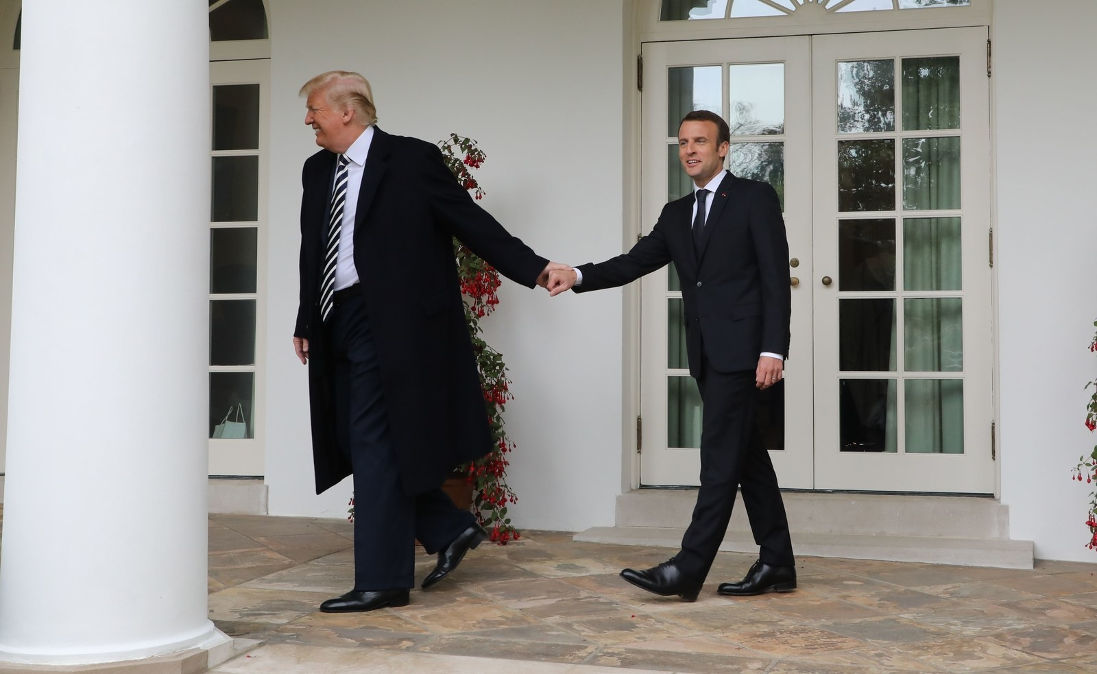 French President Emmanuel Macron and President Trump walk to the Oval Office on April 24.