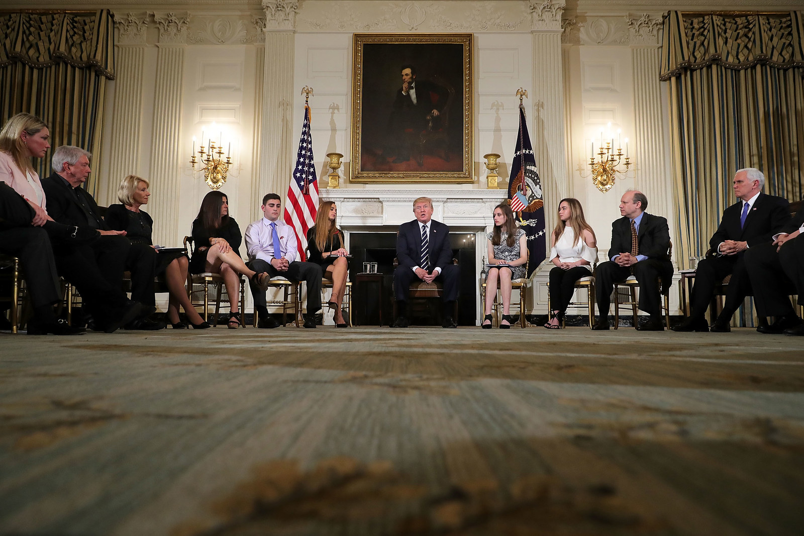 Trump holds a listening session with student survivors of mass shootings, their parents and teachers at the White House on February 21.