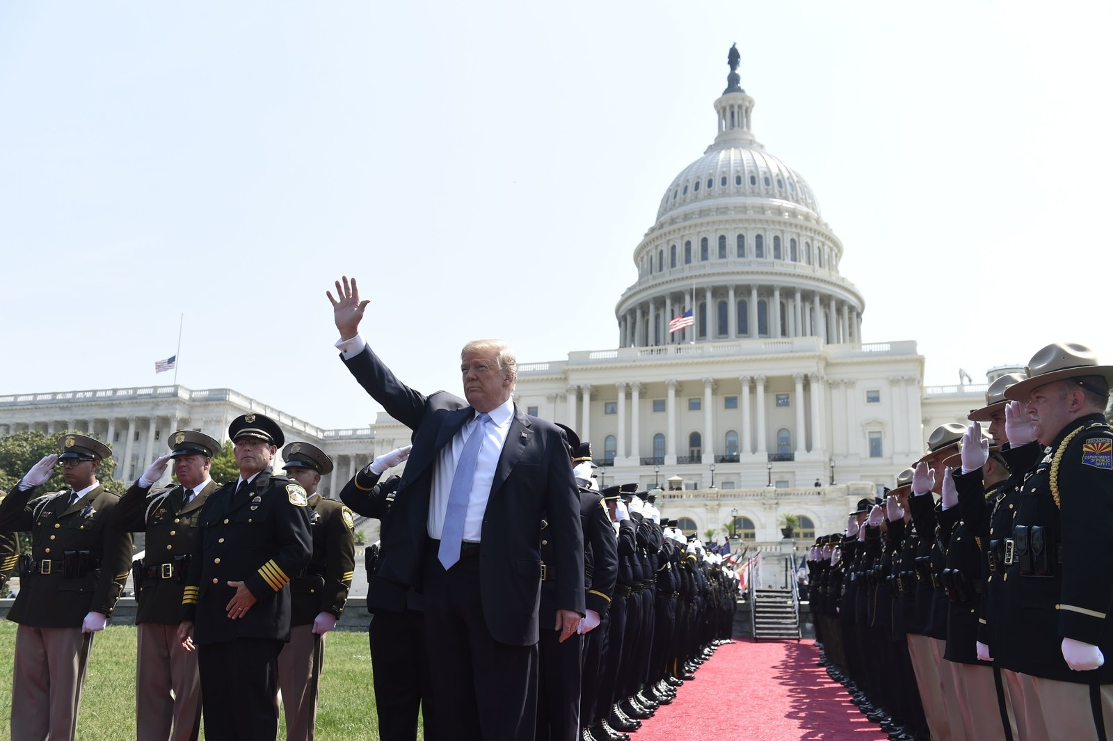 Trump waves as he arrives to address the 37th Annual National Peace Officers Memorial Service at the US Capitol on May 15.