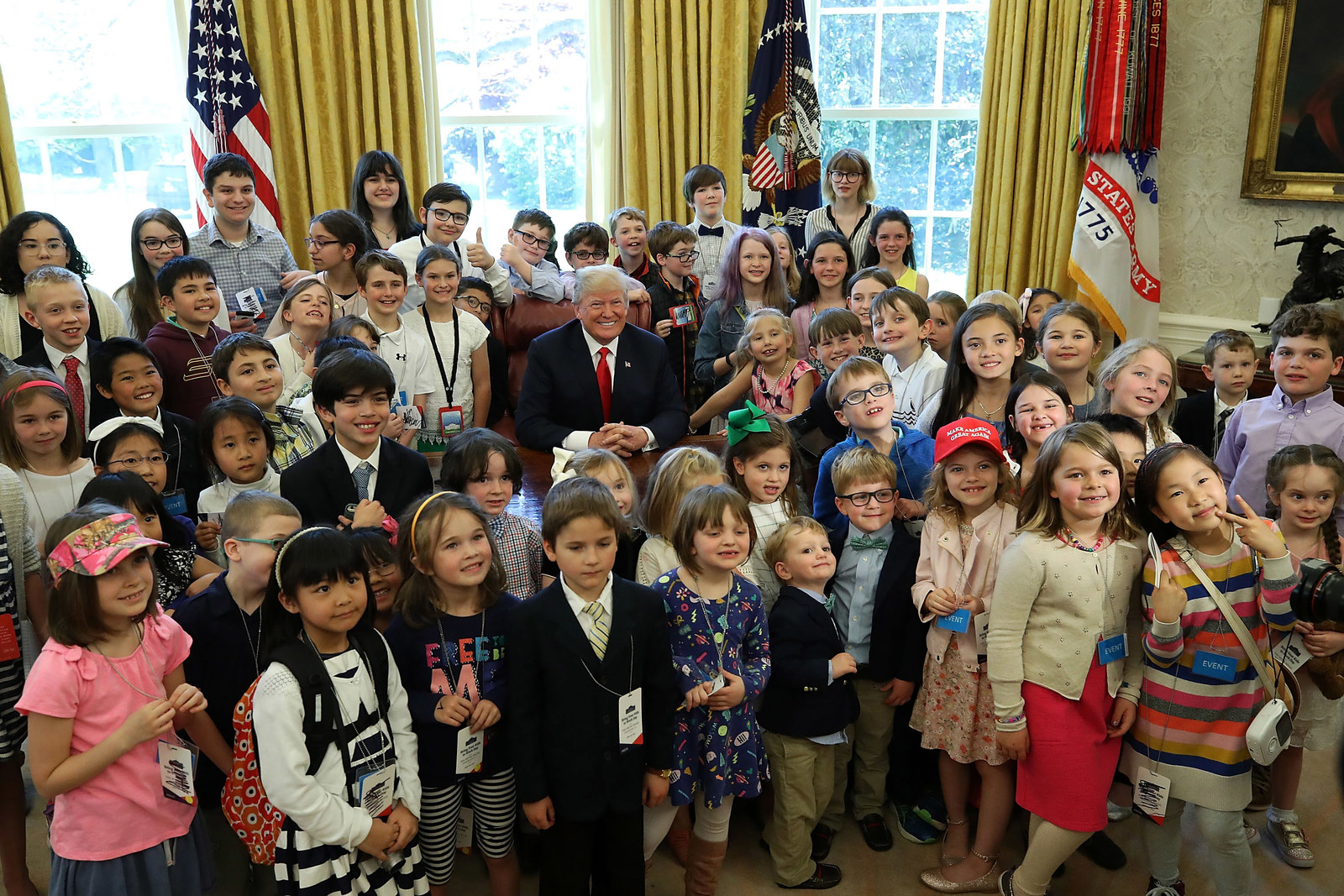 Trump is surrounded by the children of members of the media and White House staff during Take Your Child To Work Day on April 26.