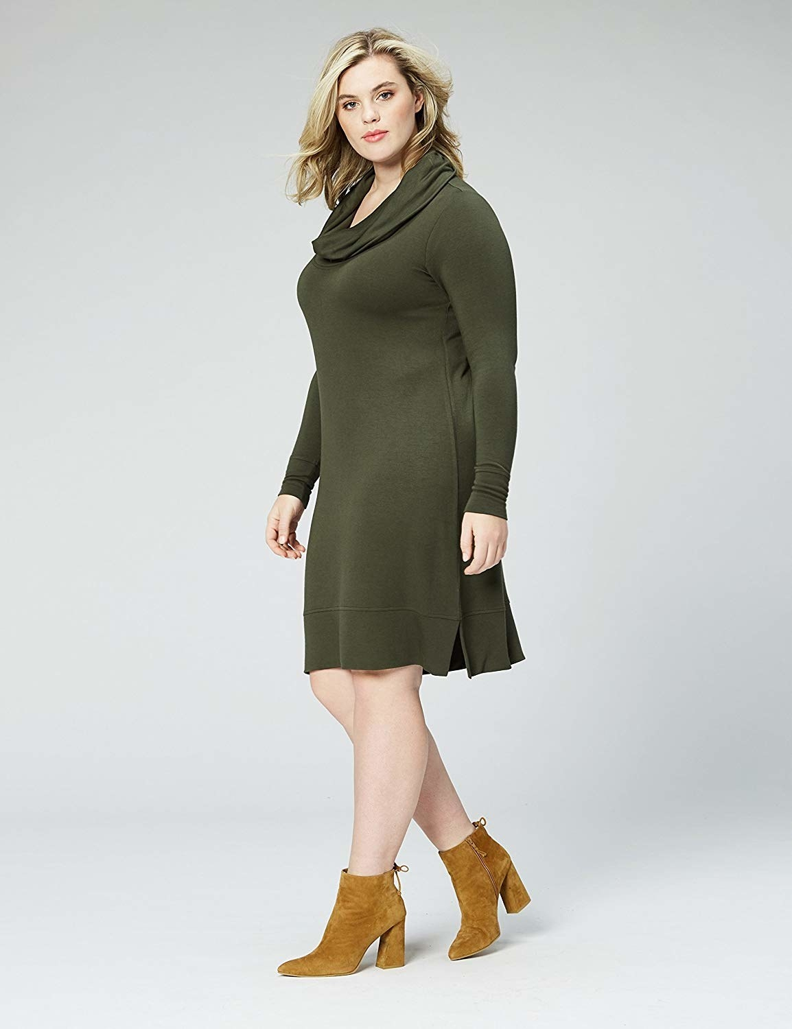 Plus size dress in olive green with loose neck, long sleeves, flowing skirt, and figure-hugging fabric