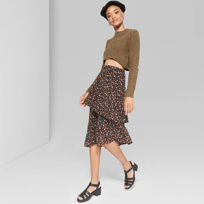 d8b7afc5ae5 An asymmetrical ruffle skirt that'll keep your closet in ~full bloom~ all  year long, thanks to its versatility. Sweater and tights? Check. Cami and  sandals?