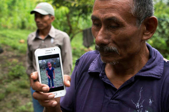 Domingo Caal, 61, Jakelin's grandfather, displays her photo on his cellphone.