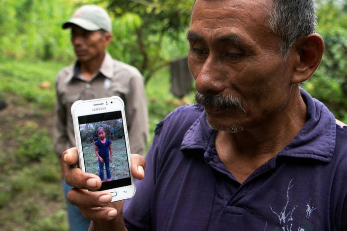Domingo Caal, 61, Jakelin's grandfather, displays her photo on his cellphone.