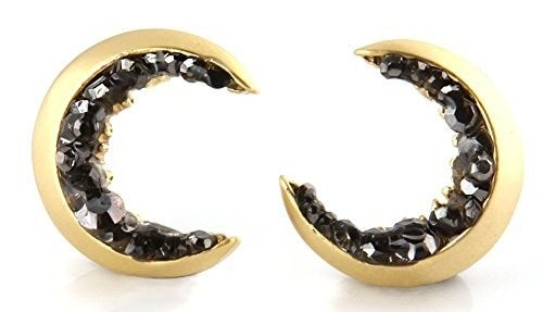 crescent moon shape earrings with black rhinestones on them