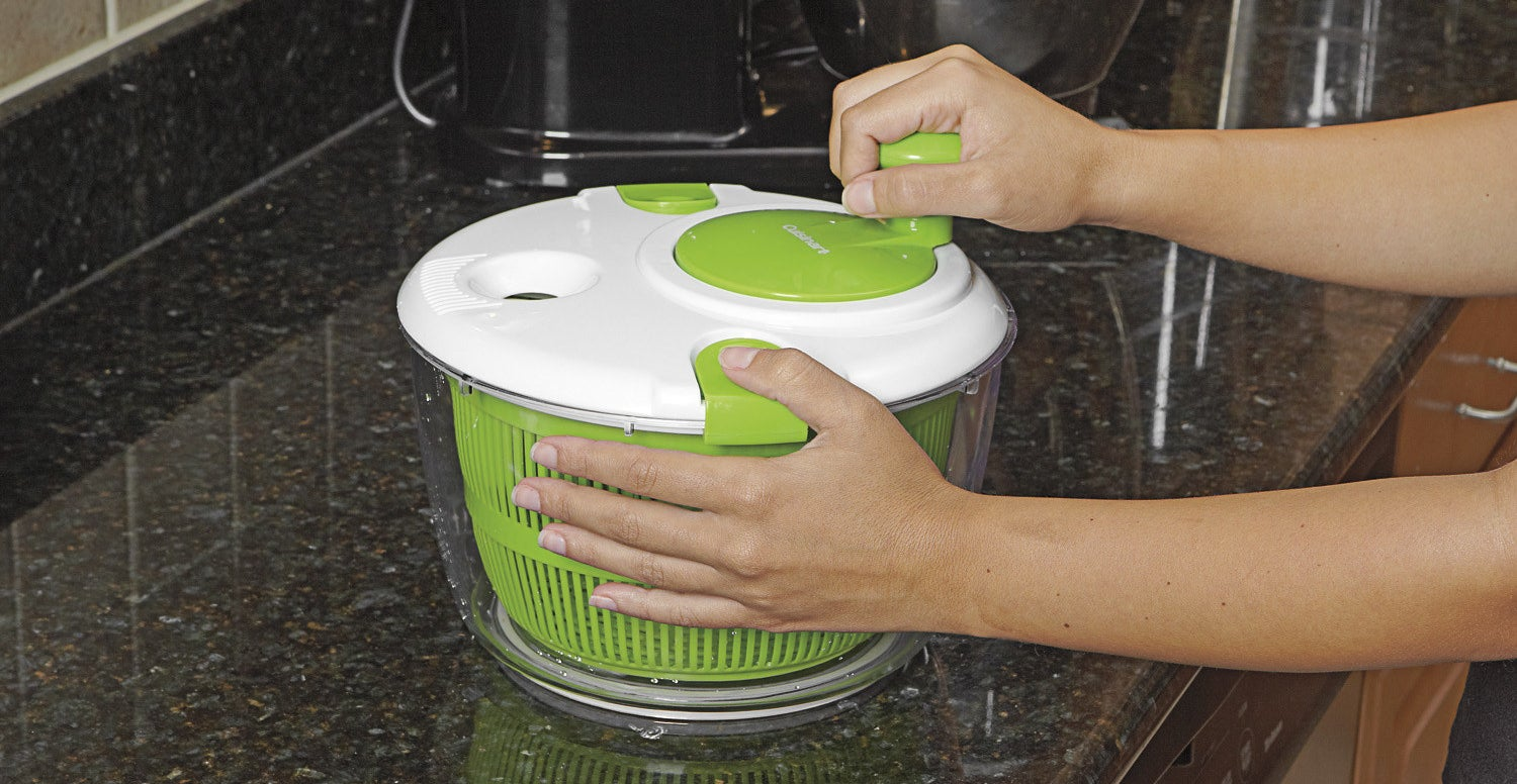 You can add and drain water without having to remove the lid. The clear base can be used as a serving bowl. It features an easy-to-turn spin knob, a non-skid base, and a 5 qt. capacity. Perfect for washing and spin-drying salad greens, fruits, and veggies. Plus, it locks to securely close the spinner.Get it from Walmart or Jet for $14.99.