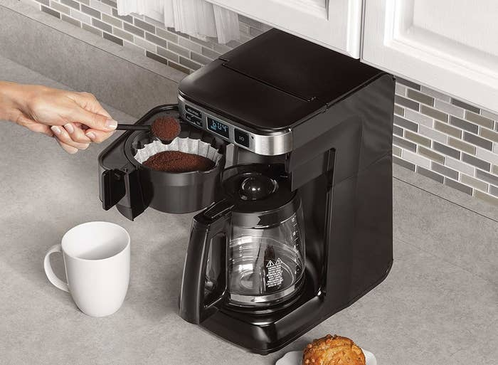 """This programmable coffee maker automatically shuts off after two hours. It has bold, regular, and one- to four-cup brewing options. The carafe has a 12-cup capacity so there'll be plenty of coffee for the whole family.Promising review: """"This is a total game changer. I was spending so much money and time on daily coffees at the shop. I needed an alternative to my routine. The programmable feature was a game changer for me. If I prep the night before, I wake up to freshly brewed coffee, and I save so much time! Not to mention money — this thing pays for itself in no time."""" —T. LatortueGet it from Amazon for $34.99."""