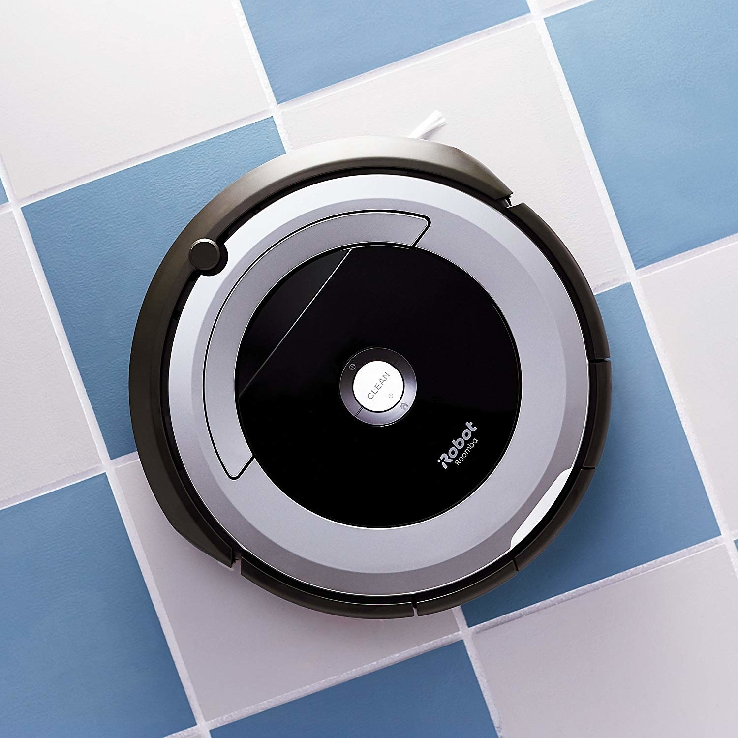 the circular robot vacuum on a tile floor