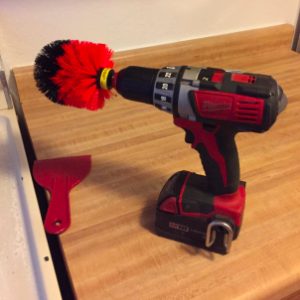 the brush attachment on a drill