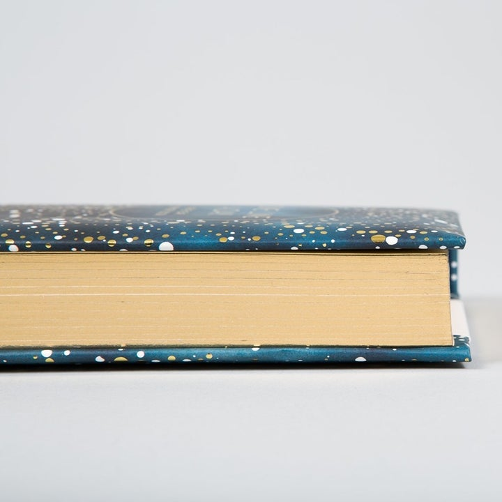 the side shows golden lined pages