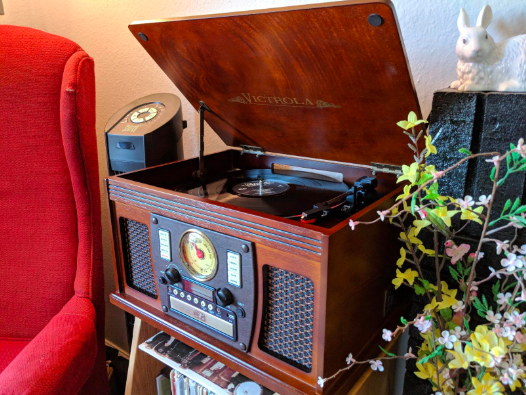 the retro looking entertainment center with a nice wooden finish