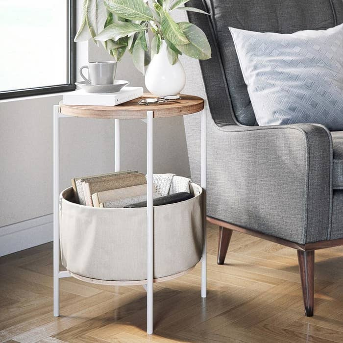 "Promising review: ""Perfect side table for the living room. This side table took less than 15 minutes to put together, is well made, and looks great once assembled. It has a top shelf and a bottom shelf. The basket sits on the bottom shelf and hangs off of the legs. It is perfect size to set your drinks, cell phone, or other items that you want within reach. I'll be ordering another one to go on the other side of my living room."" —SpringPrice: $55.35 (originally $69.19)"