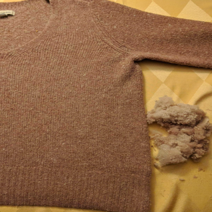 the same sweater after, no more pills, a large pile of lint that was the pills set off to the side