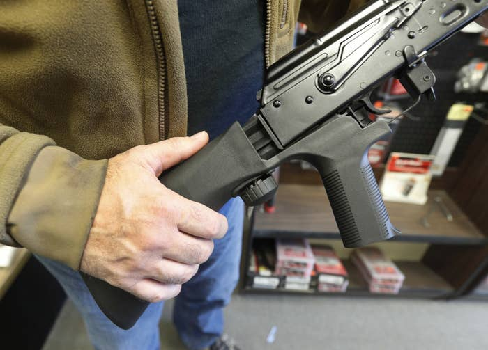 A bump stock device that fits on a semi-automatic rifle to increase the firing speed.