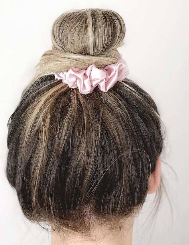 """Promising review: """"I love these! I always sleep with my hair up, and these scrunchies not only keep my hair from creasing, but the satin is better for my hair at night. I use a silk pillowcase at night for the same reason. They're a great size. I absolutely love these!"""" —Amazon CustomerGet it from Amazon for $8.99+ (available in 27 colors)."""