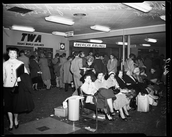 People line up to buy last-minute plane tickets on December 24.