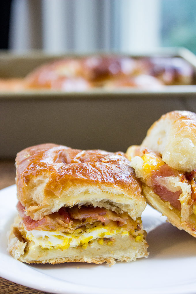 You can prepare these sliders — scramble the eggs, cook the bacon, and assemble everything between the buns — a day in advance. Then, just pop them in the oven when you're ready to eat. Get the recipe.