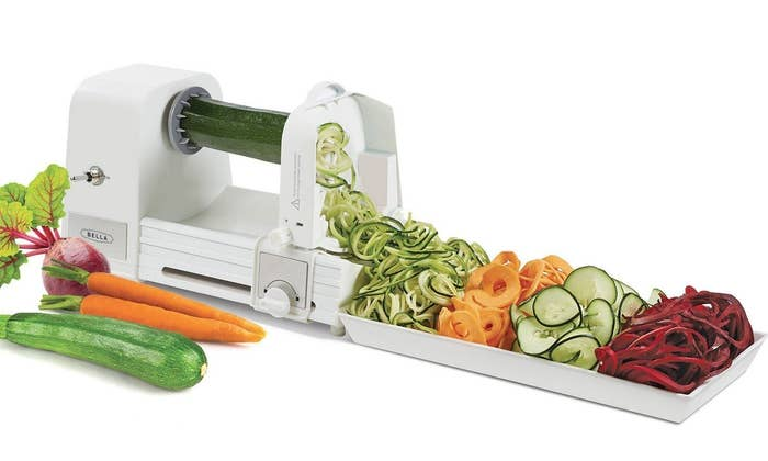 """All you have to do is insert your fave vegetable and turn the handle to create tasty veggie noodles. It's so easy even the laziest of cooks can enjoy it.Promising review: """"I was so excited to try out this spiralizer. I was trying to find ways to get my kids to eat more vegetables and I think this is a great solution. It was much more compact than I anticipated, which is great for storage. It took me a few minutes to figure out how to use the blade part of it, but once I got it figured out, it was a breeze. I tried a potato first and was impressed with how easy and quick it took to make fettuccini-shaped potato strings.....so FUN!! I can't wait to try so many new veggies and fruits. I highly recommend!!"""" —Mreeves77Get it from Walmart for $22.13."""