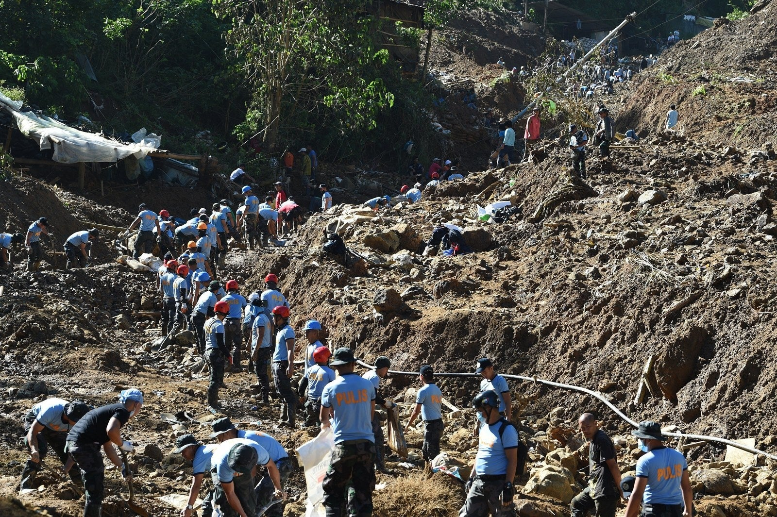 Rescuers dig at a landslide site where dozens of residents are believed to have been buried during heavy rains at the height of Typhoon Mangkhut in Itogon, Benguet province, the Philippines, on Sept. 18.