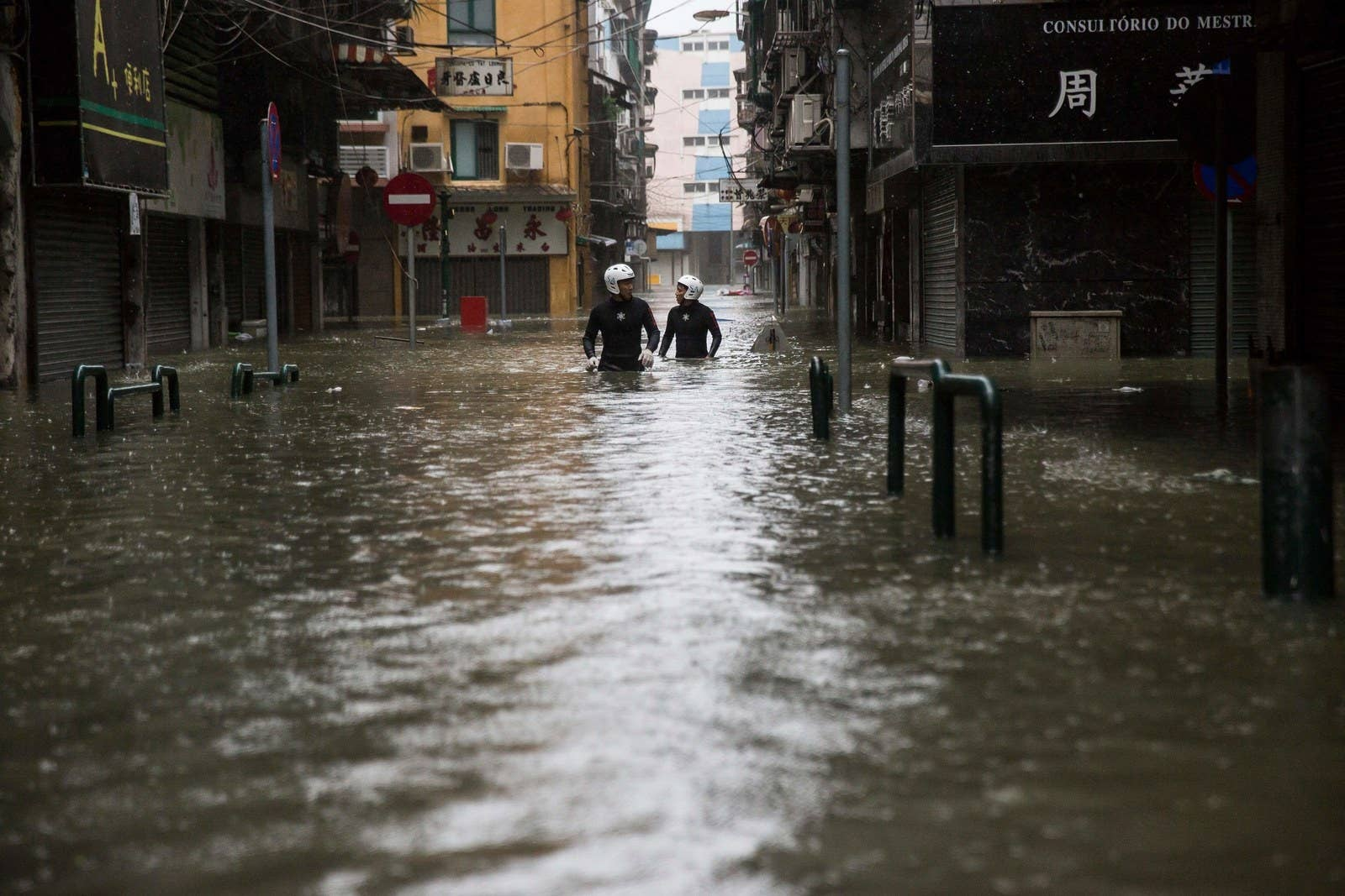Rescue workers make their way through floodwaters during a rescue operation after Super Typhoon Mangkhut passed through Macau on Sept. 16.