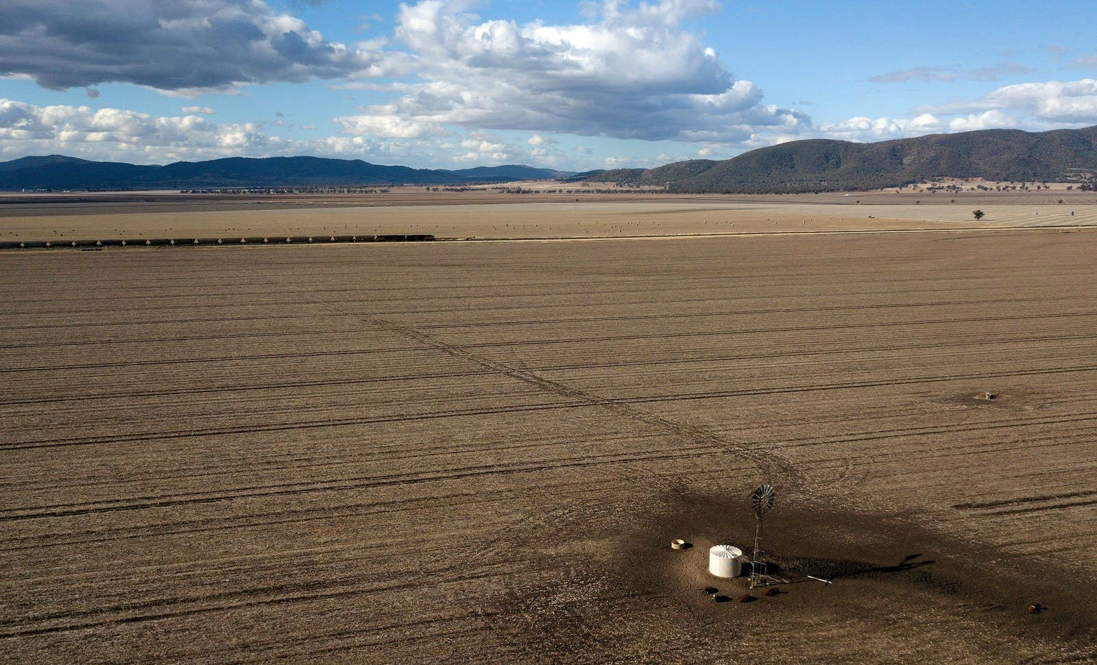 A train makes its way through dry paddocks in the drought-hit area of Quirindi in New South Wales, Australia.