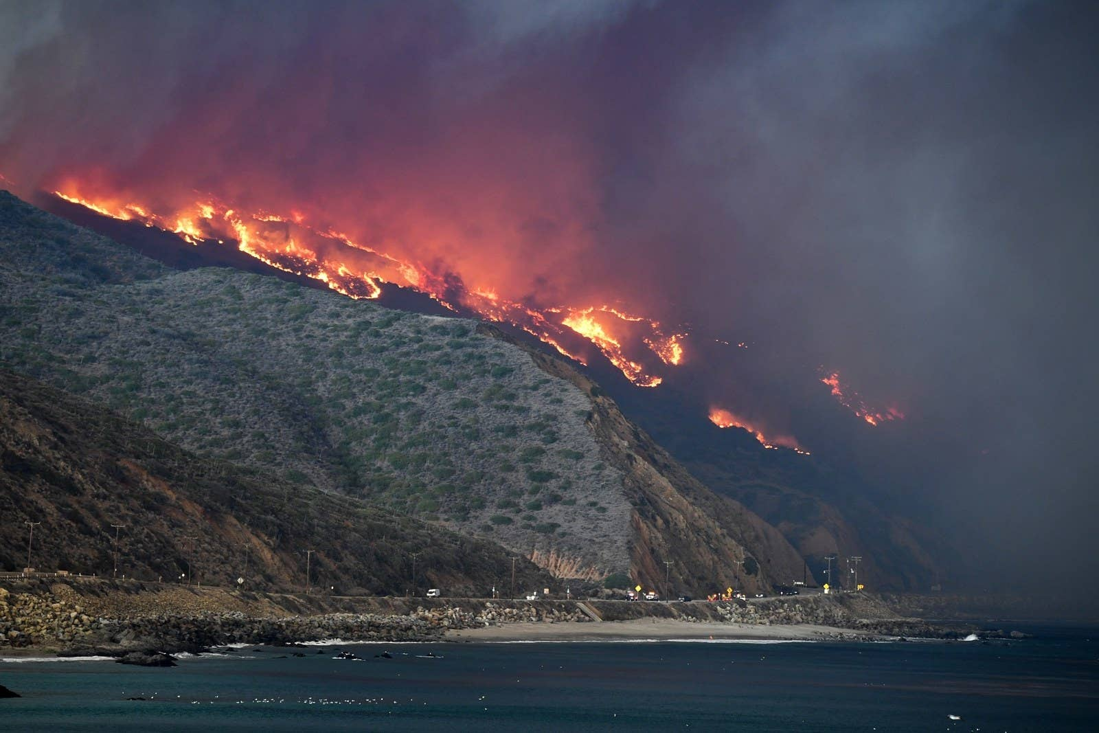 The Woolsey fire reaches the ocean along the Pacific Coast Highway near Malibu, Nov. 9.