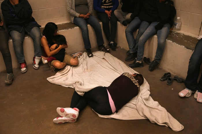 Women and children wait in a holding cell at a US Border Patrol processing center after being detained near McAllen, Texas.