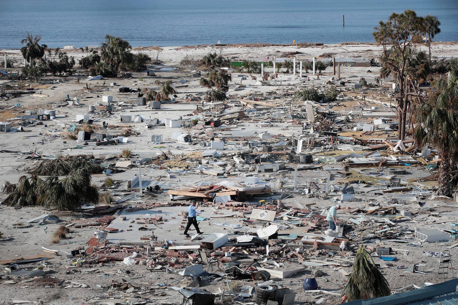 A man walks through Mexico Beach, Florida, Oct. 16.