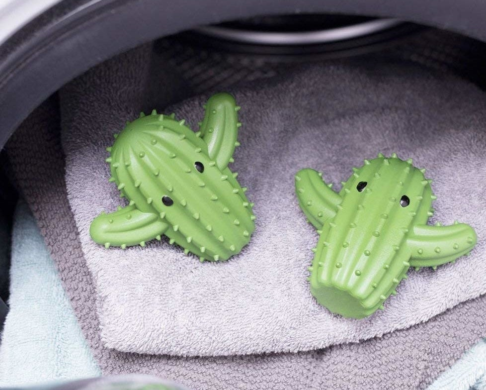 The cactus-shaped balls on top of towels