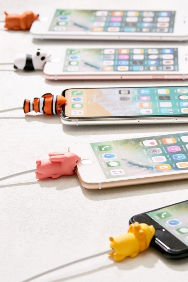 """The animal-shaped gadgets who hug cords to keep them from bending when plugged in, looking like they're """"biting"""" the device"""