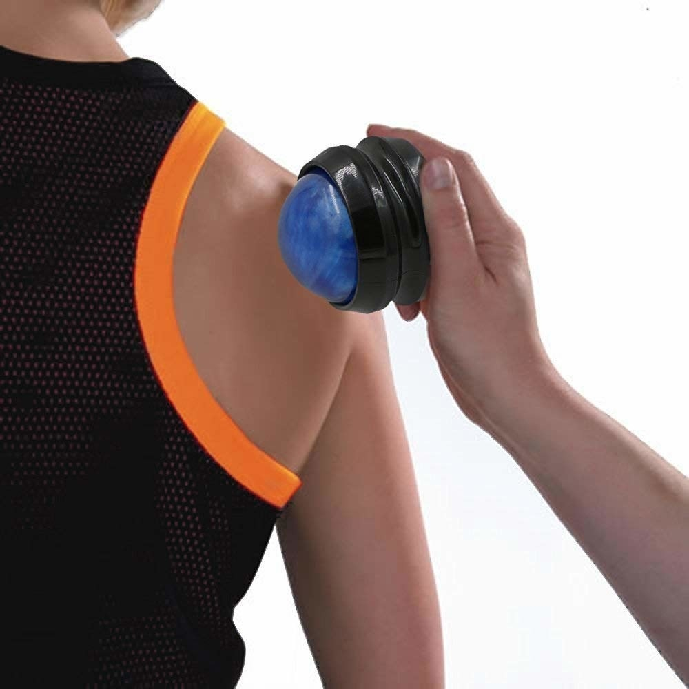 A model holding the rolling ball above someone's shoulder
