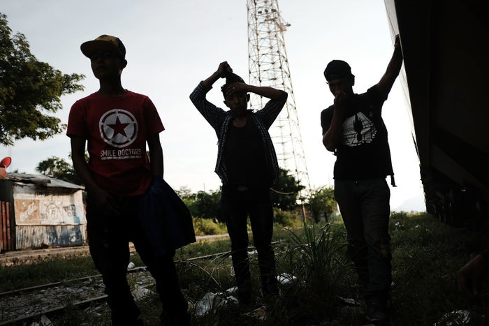 A group of Honduran teens walking in a migrant caravan wait for a train in Ixtepec, Mexico, in October.