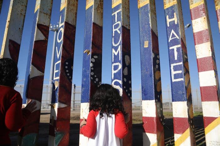 A girl looks toward the US at the US–Mexico border fence in Tijuana, Mexico.