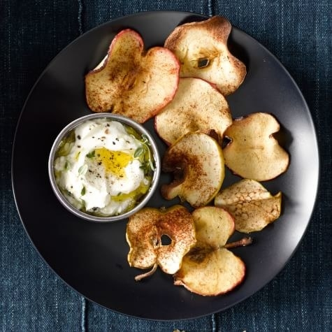 Thinly Sliced Apple Chips Snack  -  Look, you can either shell out $10 to buy a bougie bag of apple chips at your local health store, or simply make apple chips at home with just a dash of cinnamon, sugar, and salt. Get the  recipe .