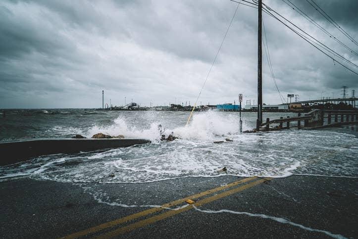 Water crashing over bridge during Hurricane Harvey in Kemah Texas