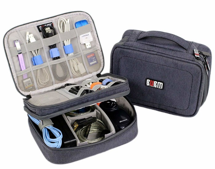 """Promising review: """"This gear organizer is so handy! It has two separately zipped sections: the top for very small items like wires and the bottom for larger ones like chargers, power supplies, and bulkier wires. Now all these little pieces fit in one small case where I can find them easily. It's laid out so that each item is held in its own space, but when you open it you can see everything. The organizer is soft-sided and weighs practically nothing."""" —S. BrannGet it from Amazon for $16.99+ (available in five colors)."""