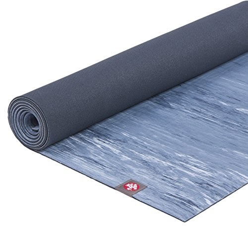 unfurling yoga mat with pretty abstract design on it