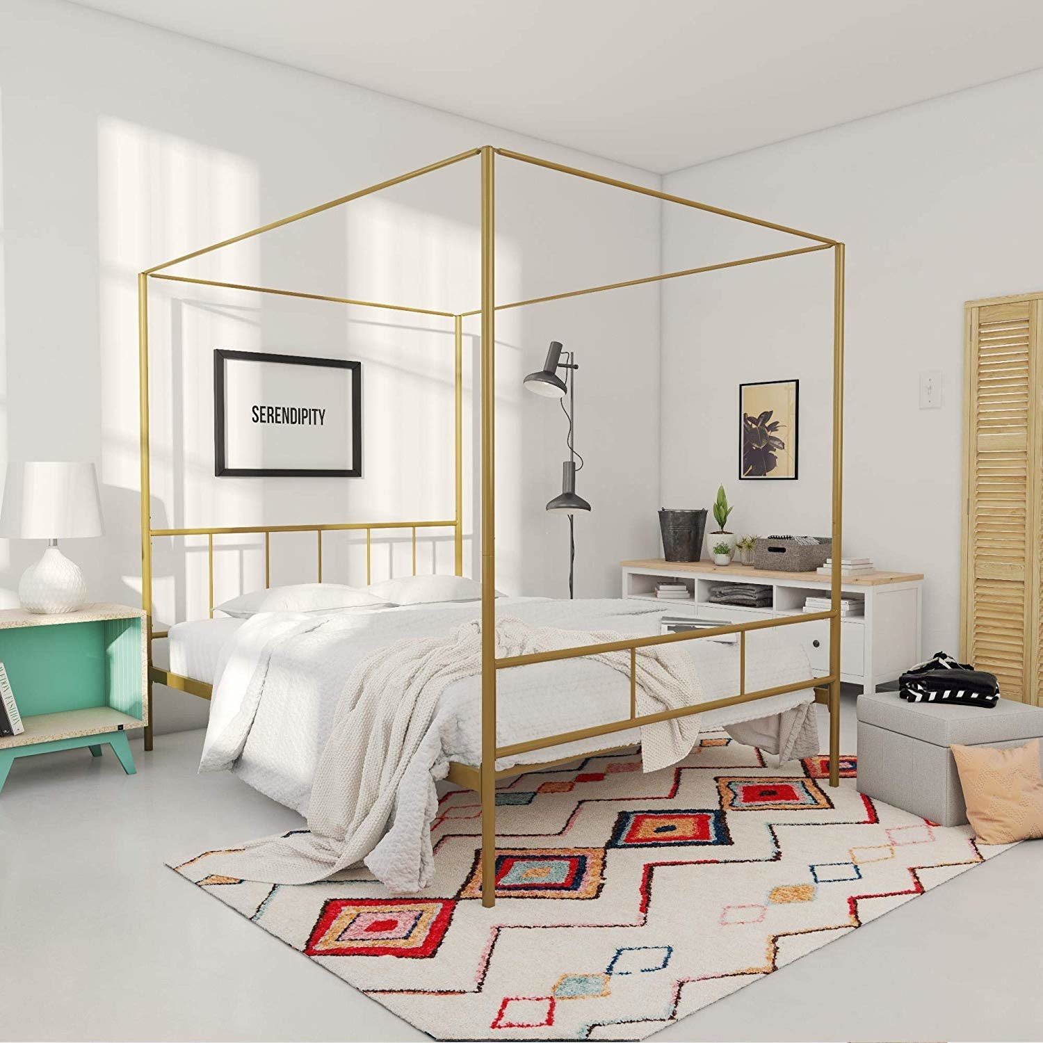 bedroom with gold tone canopy in squared off shape