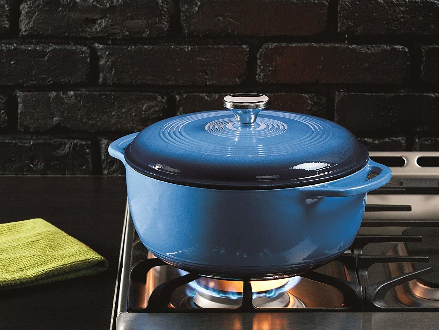 deep blue dutch oven on a stovetop